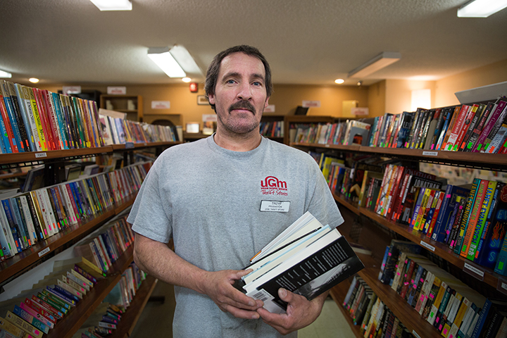 Troy in the book aisle at UGM Thrift Store