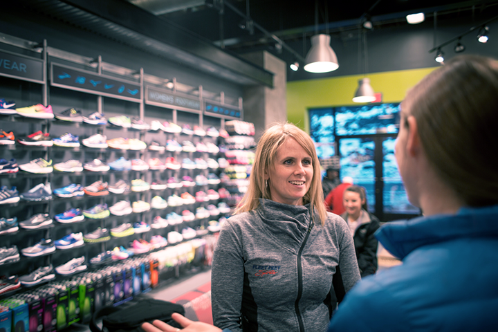 Julie talking with customer in shoe store
