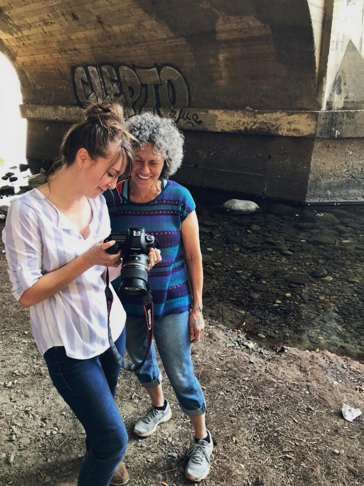 Photographer shares photo with subject being photographed