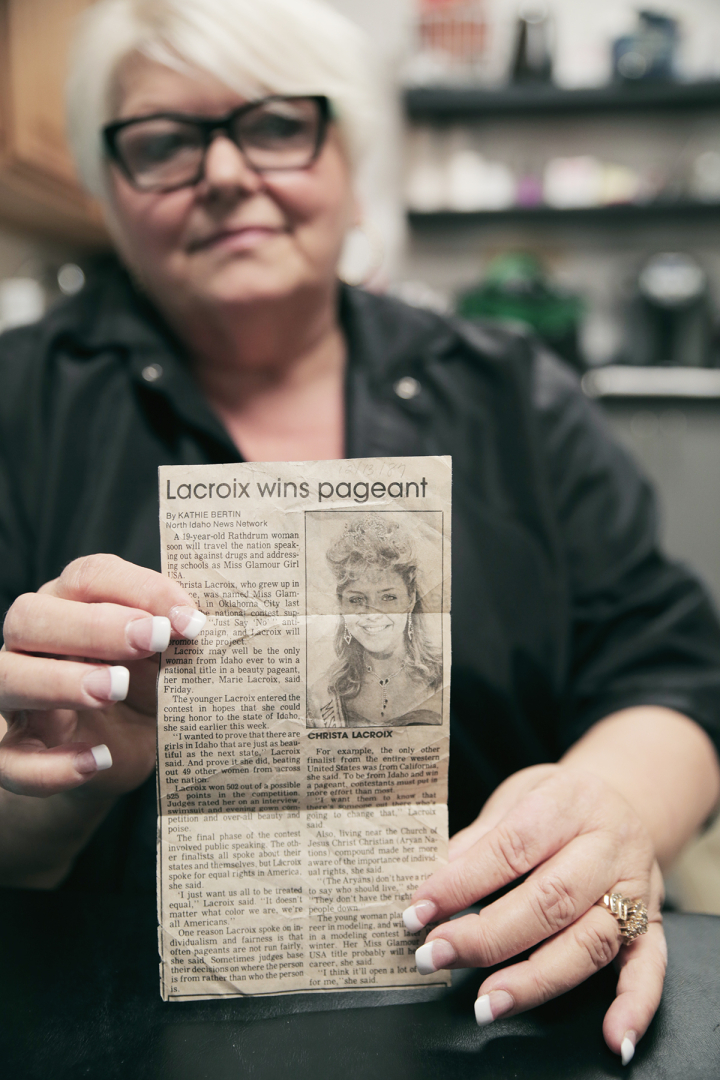 Marie holding newspaper clipping