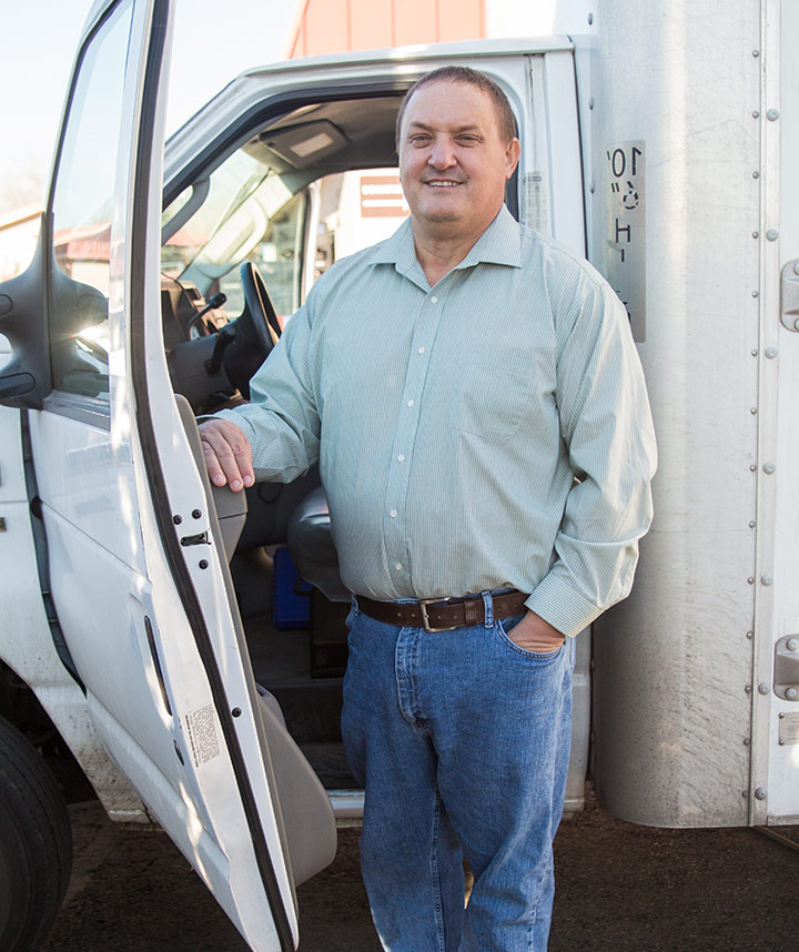 Larry standing by his truck