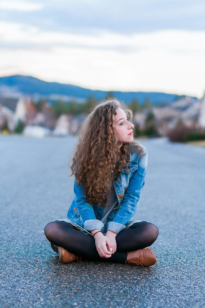 Abigail sitting in road