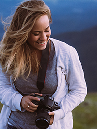 Portrait of Clare with camera
