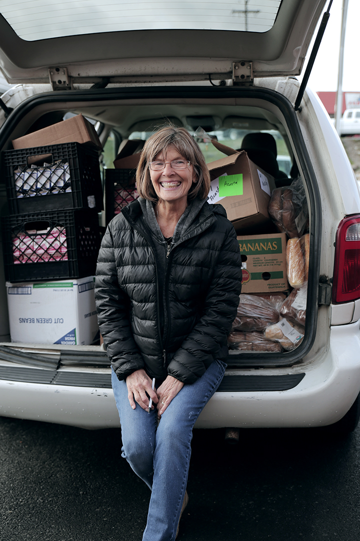 Jan with a car full of food donations
