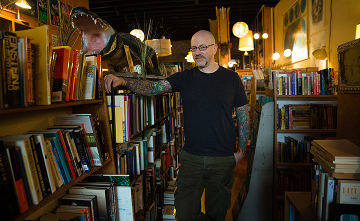 Nathan standing between book shelves