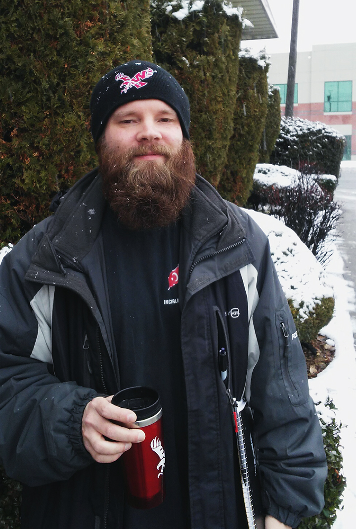 James with coffee in the snow